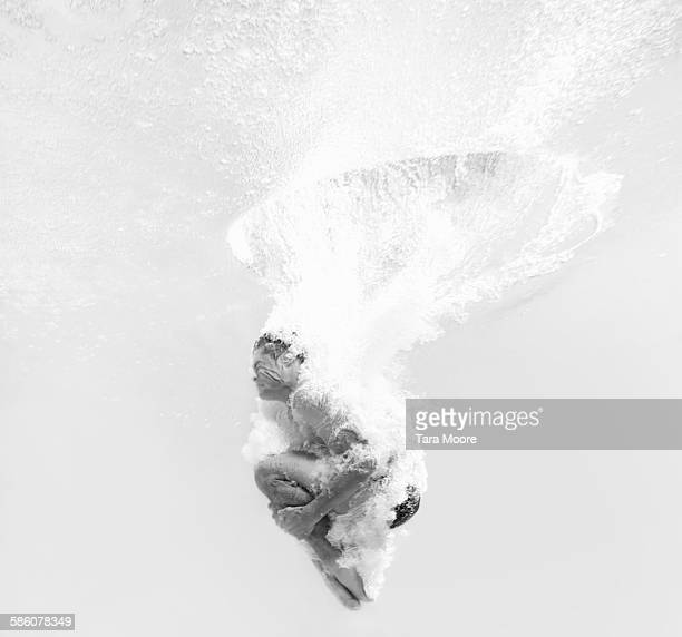 man dive bombing into water