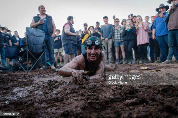 A man dives into a makeshift mud pit at the 2017 Deni Ute Muster on September 30 2017 in Deniliquin Australia The annual Deniliquin Ute Muster is the...