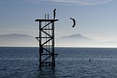 A man dives into Lake Geneva on an unusually warm day in SaintPrex on November 8 2015 as recordbreaking temperatures for the month of November hit...