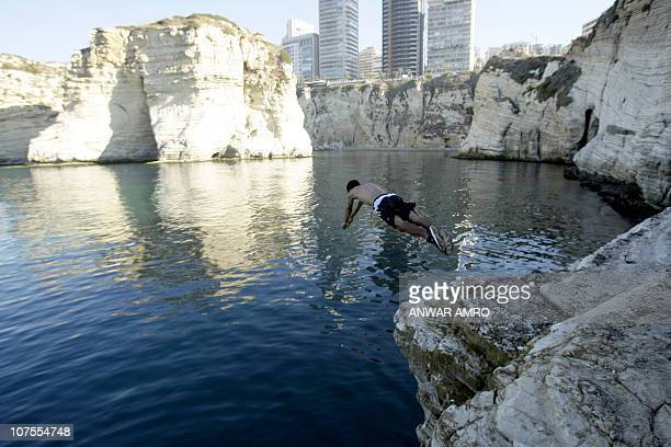 HARISSIA man dives into the Mediterranean Sea off the shores of the Lebanese capital Beirut on December 1 2010 As Europe shivers under freezing...