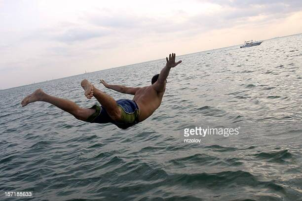 man diving in ocean