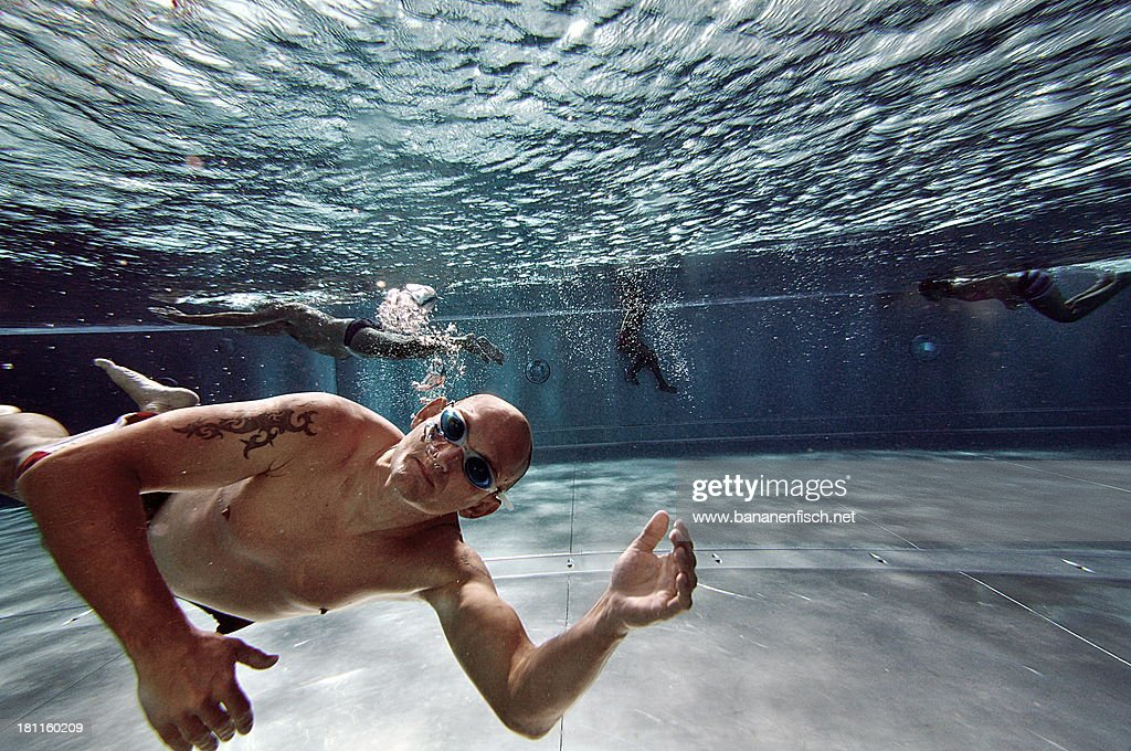 Man diving in swimming pool. : Stock Photo