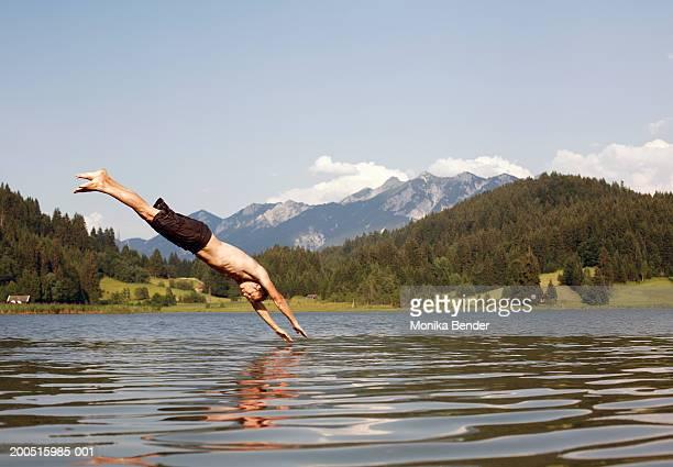 Man diving into lake