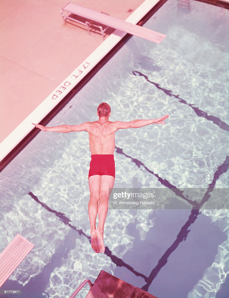 Man diving into swimming pool, overhead view. (Photo by H. Armstrong Roberts/Retrofile/Getty Images) : Stock Photo