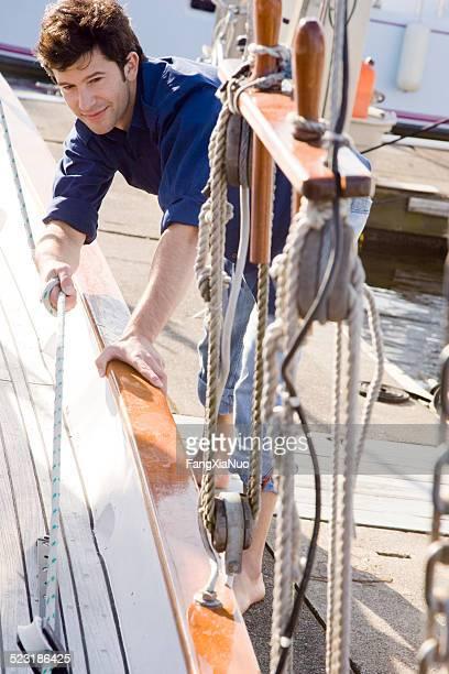 Man Docking Sailboat