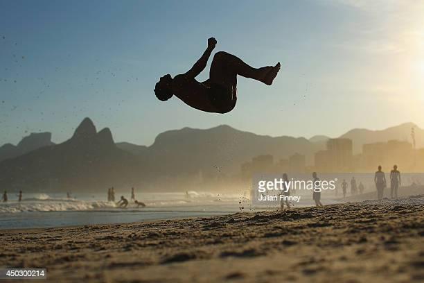 A man does a backflip on Ipanema beach on June 8 2014 in Rio de Janeiro Brazil