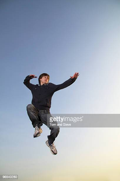 Man does a flying ninja pose through the air