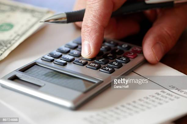 man does bills and finance with calculator