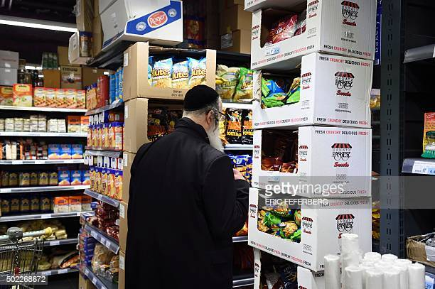A man does his shopping at the Hypercacher kosher supermarket on December 22 2015 in Paris nearly a year after a bloody hostage drama during a...