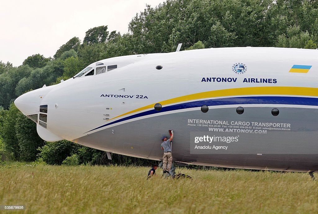 A man does maintenance to the aircraft 'AN-22' ('Antaeus') before a demonstration flight from the airfield 'Svyatoshin' (Kiev) to the airport 'Kyiv-Antonov' (Hostomel) in Kiev, Ukraine on May 30, 2016. Ukrainian aircraft 'AN-22' is restored on the aircraft factory 'Antonov' and returned to commercial operation. The 'AN-22' is the world's first wide-body transport plane and the world's largest turbo-prop airplane.