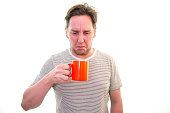 Man does not like his coffee/tea, rudeness, disgust, drinking