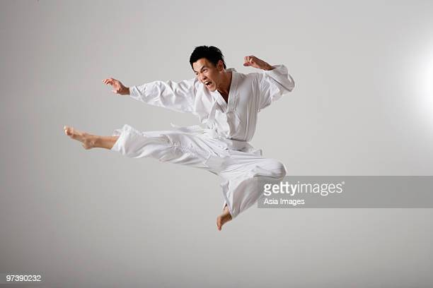 Man doing a flying kick, martial arts