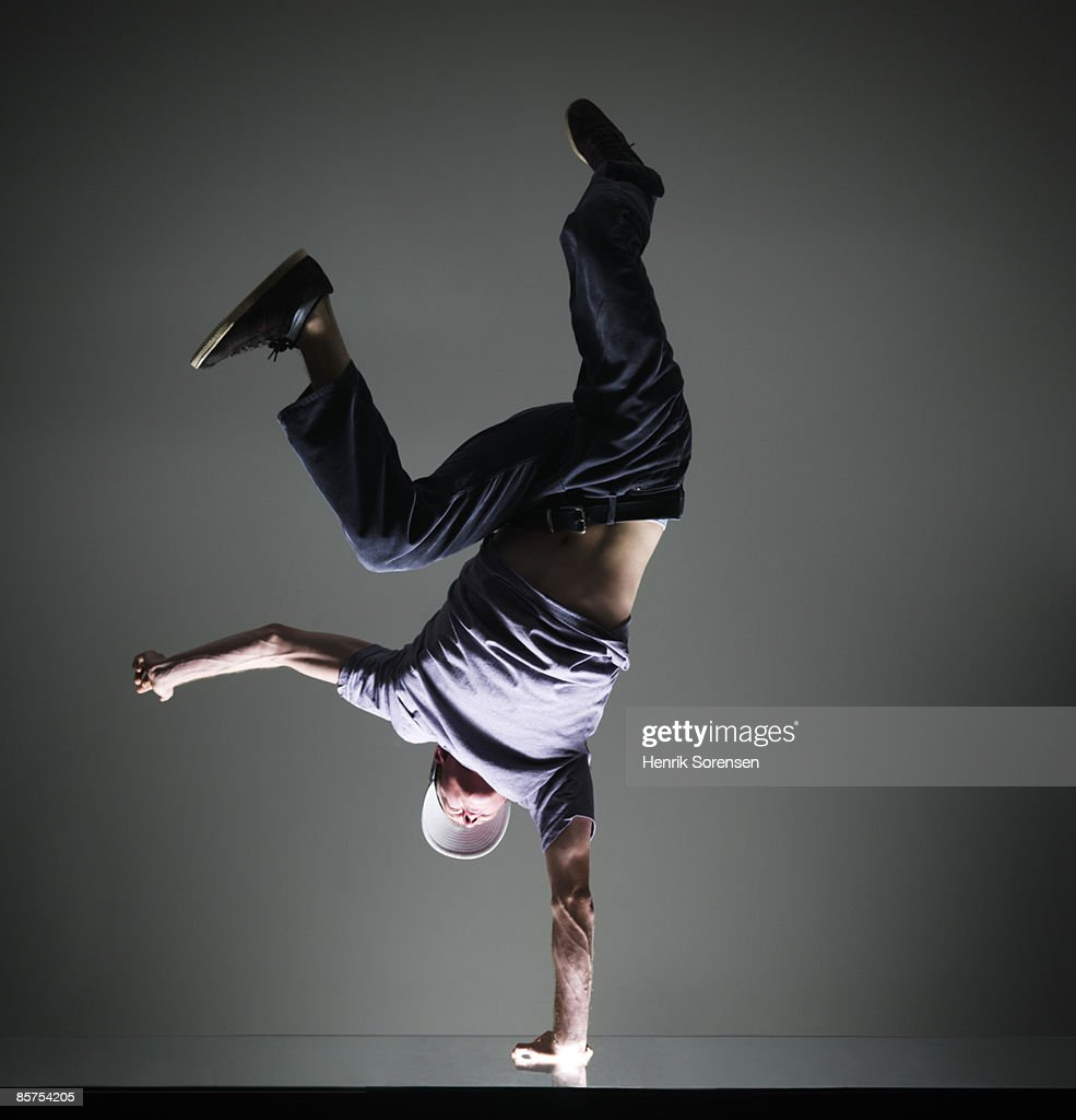Man doing a handstand on one hand : Stock Photo