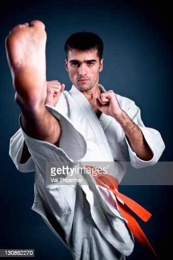 Man doing a high karate kick