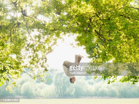 Man doing a somersault in the woods : Bildbanksbilder