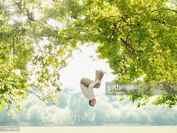 Man doing a somersault in the woods