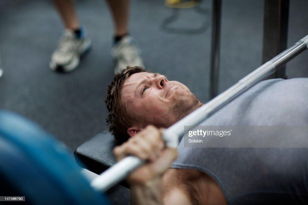 Man doing benchpress in gym : Stock Photo
