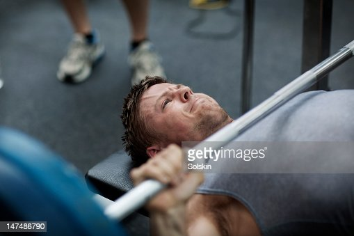 Man doing benchpress in gym : Stock Photo