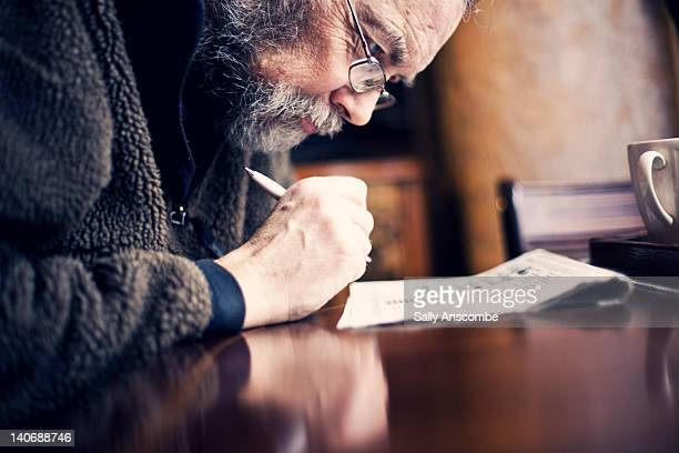 Man doing crossword in newspaper
