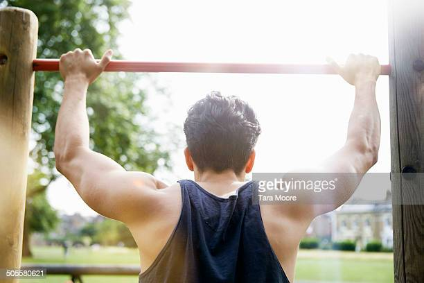 man doing exercise in park