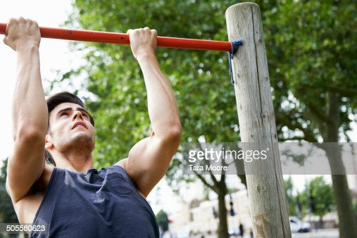 man doing exercise in park : Stock Photo