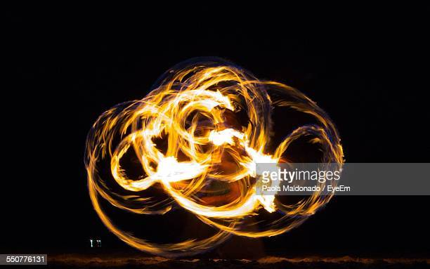 Man Doing Fire-Twirling Performance At Night