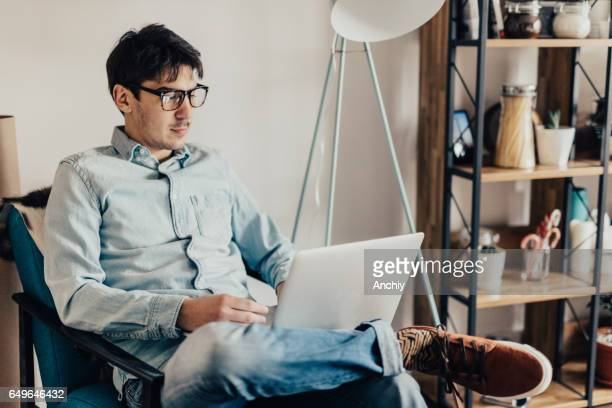 Man doing freelance work from comfortable home
