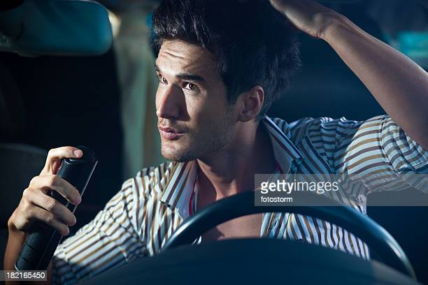 Man Doing Haircare In The Car