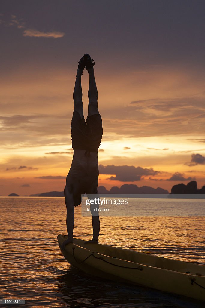 Man doing Handstand on Sea Kayak in Thailand : Stock Photo