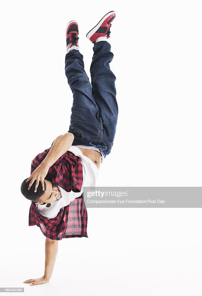 Man doing handstand : Stock Photo