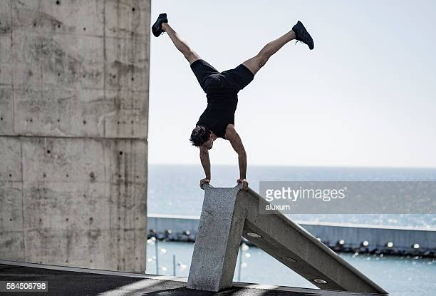 Man doing headstand in the city
