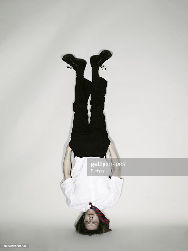 Man doing headstand : Stock Photo