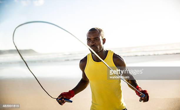 Man doing jumping rope at the beach