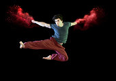man doing karate kick with red smoke
