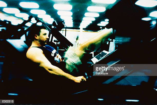 Man doing leg presses in gym