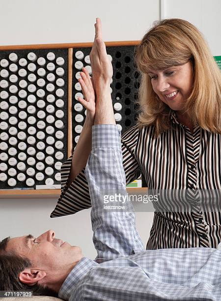Man doing muscle response test with female