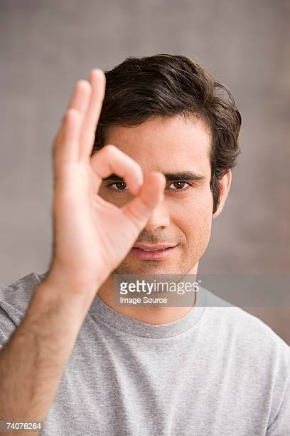 Man doing OK sign