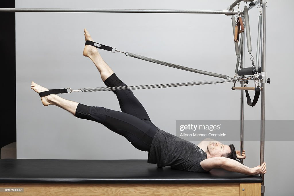 Man doing pilates : Stock Photo