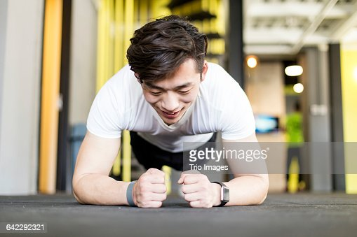 man doing plank in gym : Stock Photo