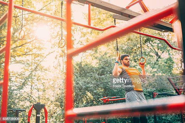 Man doing pull ups in the park