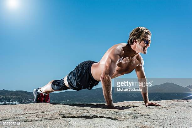 Man Doing Push Ups In The Mountains