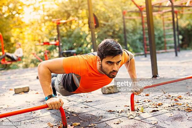 Man doing push ups in the park