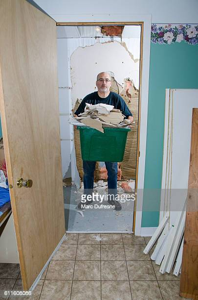 Man doing renovation in wardrobe or closet