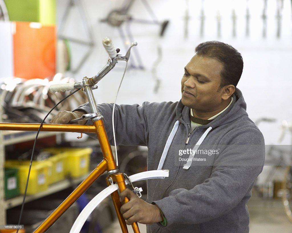 Man doing repair work on bicycle. : Stock Photo