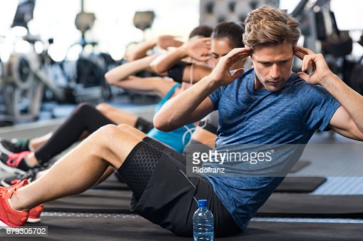 Man doing sit ups : Stock Photo