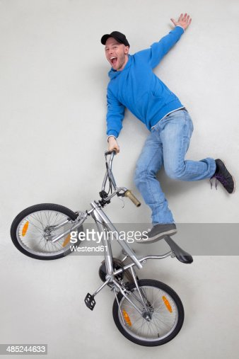 Man doing stunt on bicycle