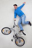 Man doing stunt on bicycle