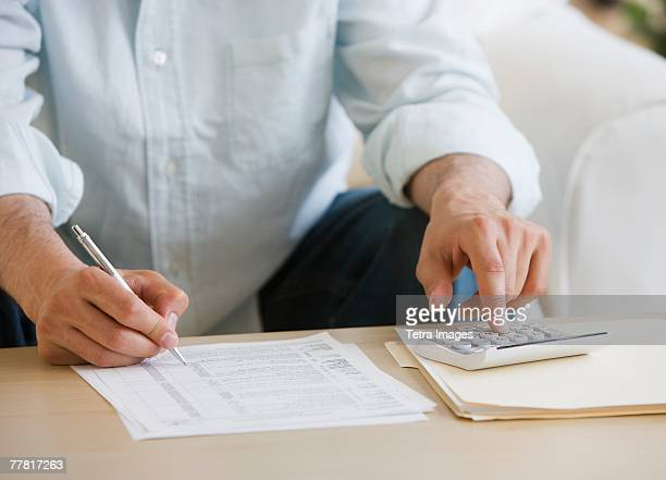 Man doing taxes at home