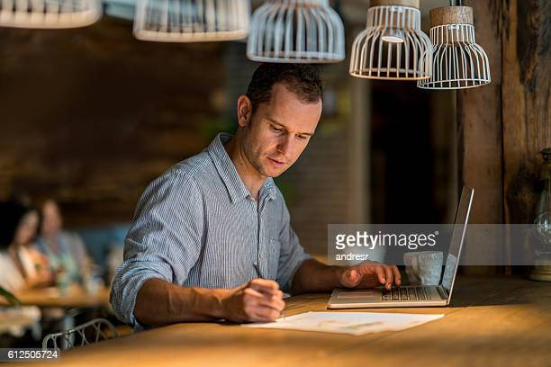 Man doing the books at a restaurant