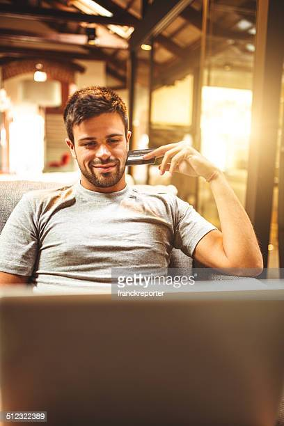 Man doing the shopping online on sofa